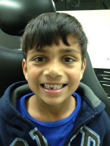 Ketan's son Kyle after losing his first tooth